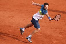 Tennis - French Open - Roland Garros - Latvia's Ernests Gulbis v Jo-Wilfried Tsonga - Paris, France - 28/05/16. Gulbis returns a shot.   REUTERS/Jacky Naegelen