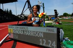 May 28, 2016; Eugene, OR, USA; Kendra Harrison (USA) poses with the scoreboard after winning the women's 100m hurdles in an American record 12.24 during the 42nd Prefontaine Classic at Hayward Field. Mandatory Credit: Kirby Lee-USA TODAY Sports