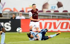 May 11, 2016; Commerce City, CO, USA; Colorado Rapids midfielder Sam Cronin (6) attempts to shoot the ball as Sporting Kansas City defender Nuno Coelho (12) defends in the first half at Dicks Sporting Goods Park. Mandatory Credit: Ron Chenoy-USA TODAY Sports
