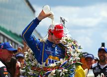 May 29, 2016; Indianapolis, IN, USA; IndyCar Series driver Alexander Rossi dunks himself with milk as he celebrates after winning the 100th running of the Indianapolis 500 at Indianapolis Motor Speedway. Mandatory Credit: Mark J. Rebilas-USA TODAY Sports