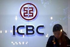 A teller at a branch of the Industrial and Commercial Bank of China (ICBC) works behind the counter in central Sydney, Australia, April 7, 2016.  REUTERS/David Gray