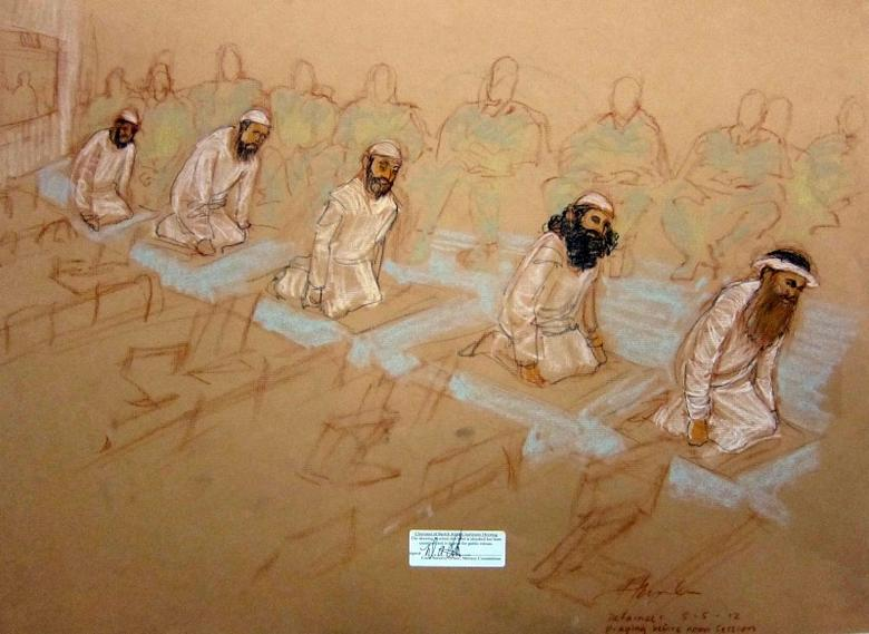 Mustafa al Hawsawi, Ammar al Baluchi, Ramzi bin al Shibh,  Walid Bin Attash, and Khalik Sheikh Mohammad, pray at their arraignment in this courtroom sketch reviewed and approved for release by a U.S. military security official, at Guantanamo Bay Navy Base, Cuba, May 5, 2012. REUTERS/Janet Hamlin/Pool