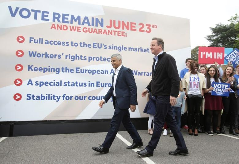 Britain's Prime Minister David Cameron (R) makes a joint appearance with Mayor of London Sadiq Khan as they launch the Britain Stronger in Europe guarantee card at Roehampton University in West London, Britain May 30, 2016. REUTERS/Yui Mok/Pool