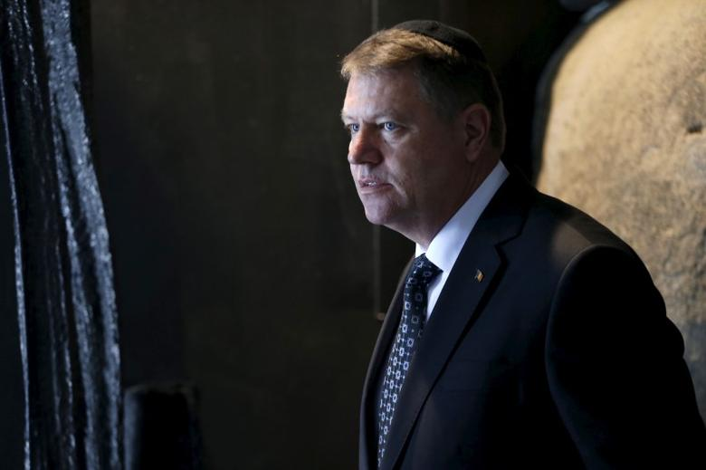 Romanian President Klaus Iohannis walks during a ceremony in Jerusalem March 8, 2016. REUTERS/ Ammar Awad