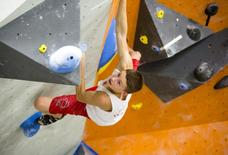 Drew Ruana, 16, a competitive climbing national champion, trains at Stone Gardens rock climbing gym in Bellevue, Washington October 20, 2015. REUTERS/Jason Redmond