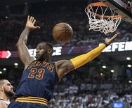 May 27, 2016; Toronto, Ontario, CAN; Cleveland Cavaliers forward LeBron James (23) scores a basket  during the third quarter of game six of the Eastern conference finals of the NBA Playoffs against the Toronto Raptors at Air Canada Centre. Mandatory Credit: Nick Turchiaro-USA TODAY Sports