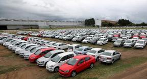 New cars are parked at a stock area of German automaker Volkswagen's plant in Taubate, Brazil, June 19, 2015. Volkswagen AG Taubate plant, the second largest in Brazil, which produce the top-selling Gol hatchback, the Voyage sedan and the Up city car has furloughed 4,200 workers for three weeks, a local union said on June 15, 2015, as disappearing demand forces carmakers in the country to manage excess capacity. Brazil's auto industry is expecting this year's downturn to be its worst since 1998, according to national automakers association Anfavea, which slashed its 2015 outlook for the second time in two months. REUTERS/Paulo Whitaker