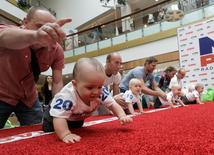 Babies crawl during the Baby Race to mark international Children's Day in Vilnius, Lithuania, June 1, 2016. REUTERS/Ints Kalnins