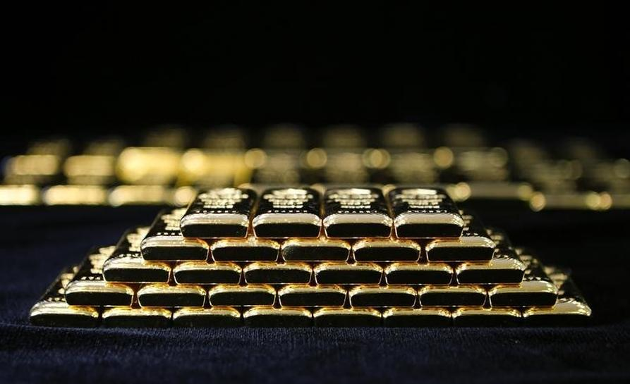 Gold jumps more than 2 pct after U.S. payrolls data | Reuters