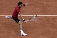 Tennis - French Open Mens Singles Semifinal match - Roland Garros - Novak Djokovic of Serbia v Dominic Thiem of Austria - Paris, France - 03/06/16. Novak Djokovic returns a shot. REUTERS/Jacky Naegelen