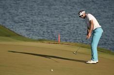May 14, 2016; Ponte Vedra Beach, FL, USA; Ian Poulter putts on the 18th green during the third round of the 2016 Players Championship golf tournament at TPC Sawgrass - Stadium Course. Mandatory Credit: John David Mercer-USA TODAY Sports