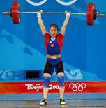 Marina Shainova of Russia lifts 129kg in the women's 58kg Group A clean and jerk weightlifting competition at the Beijing 2008 Olympic Games August 11, 2008.     REUTERS/Yves Herman
