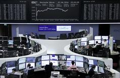 Traders work at their desks in front of the German share price index, DAX board, at the stock exchange in Frankfurt, Germany, June 7, 2016.     REUTERS/Staff/Remote
