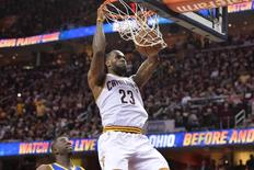 Jun 8, 2016; Cleveland, OH, USA; Cleveland Cavaliers forward LeBron James (23) dunks the ball in front of Golden State Warriors forward Draymond Green (23) during the four quarter in game three of the NBA Finals at Quicken Loans Arena. Mandatory Credit: Ken Blaze-USA TODAY Sports