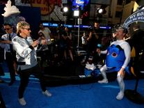 "Cast member Ellen DeGeneres squirts tequila during a gag for her television show at the premiere of ""Finding Dory"" at El Capitan theatre in Hollywood, California U.S., June 8, 2016.   REUTERS/Mario Anzuoni"
