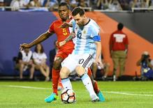 Argentina midfielder Lionel Messi (10) scores a goal against Panama defender Roderick Miller (5) in the second half during the group play stage of the 2016 Copa America Centenario at Soldier Field. Mandatory Credit: Mike DiNovo-USA TODAY Sports