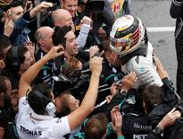 Formula One - Canadian Grand Prix - Montreal, Quebec, Canada - 12/6/16 - Mercedes driver Lewis Hamilton celebrates winning the race.  REUTERS/Chris Wattie