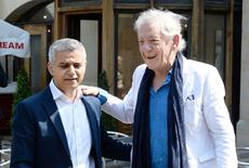 Actor Ian McKellen greets the newly elected Mayor of London Sadiq Khan (L) ahead of his signing ceremony at Southwark Cathedral, central London, Britain May 7, 2016. REUTERS/John Stillwell/Pool