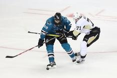 Jun 12, 2016; San Jose, CA, USA; San Jose Sharks defenseman Brent Burns (88) battles for the puck with Pittsburgh Penguins center Evgeni Malkin (71) in the third period of game six of the 2016 Stanley Cup Final at SAP Center at San Jose. Mandatory Credit: John Hefti-USA TODAY Sports