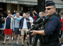 England and Wales fans react after some scuffles with Russian supporters outside a pub in Lille, France, June 14, 2016. REUTERS/Pascal Rossignol