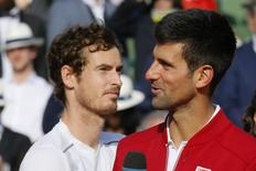 Tennis - French Open Men's Singles Final match - Roland Garros - Novak Djokovic of Serbia  v Andy Murray of Britain Paris, France, 05/06/16. Djokovic delivers a speach next to Murray.  REUTERS/Gonzalo Fuentes