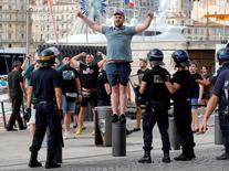 A Russian fan taunts English fans ahead of England's EURO 2016 match against Russia in Marseille, France, June 10, 2016. REUTERS/Jean-Paul Pelissier