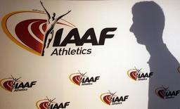 A man casts his shadow following a press conference by Sebastian Coe, IAAF's President, as part of the 203nd International Association of Athletics Federations (IAAF) council meeting  in Monaco, March 11, 2016.   REUTERS/Eric Gaillard