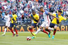 United States forward Clint Dempsey (8) dribbles while defended by Ecuador defender Frickson Erazo (3) and midfielder Fernando Gaibor (8) during the second half of quarter-final play in the 2016 Copa America Centenario soccer tournament at Century Link Field. Mandatory Credit: Joe Nicholson-USA TODAY Sports