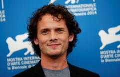 """Cast member Anton Yelchin poses during the photo call for the movie """"Burying the ex"""" at the 71st Venice Film Festival September 4, 2014. REUTERS/Tony Gentile"""