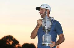 Jun 19, 2016; Oakmont, PA, USA; Dustin Johnson poses with the championship trophy after winning the U.S. Open golf tournament at Oakmont Country Club. Mandatory Credit: Charles LeClaire-USA TODAY Sports
