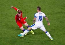 Football Soccer - Slovakia v England - EURO 2016 - Group B - Stade Geoffroy-Guichard, Saint-Etienne, France - 20/6/16 Slovakia's Juraj Kucko and England's Wayne Rooney in action REUTERS/Max Rossi
