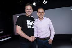 Finnish game company Supercell Co-Founder and CEO Ilkka Paananen (L) and Martin Lau, President of Tencent, pose while meeting with the press in the company's headquarters in Helsinki, Finland June 21, 2016. Lehtikuva/Seppo Samuli/via REUTERS