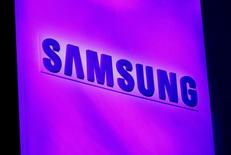 The company logo is displayed at the Samsung news conference at the Consumer Electronics Show (CES) in Las Vegas January 7, 2013. REUTERS/Rick Wilking/File Photo - RTSGH9W