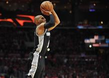 April 22, 2015; Los Angeles, CA, USA; San Antonio Spurs guard Patty Mills (8) shoots a three point basket against the Los Angeles Clippers during the second half in game two of the first round of the NBA Playoffs. at Staples Center. Mandatory Credit: Gary A. Vasquez-USA TODAY Sports