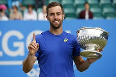 Britain Tennis - Aegon Men's Open - Nottingham Tennis Centre - 25/6/16 USA's Steve Johnson celebrates with the Trophy after winning the Mens' Singles Final Mandatory Credit: Action Images / Craig Brough Livepic