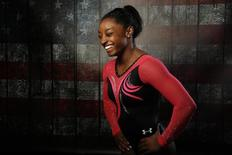 Gymnast Simone Biles laughs as she poses for a portrait at the U.S. Olympic Committee Media Summit in Beverly Hills, Los Angeles, California March 7, 2016. REUTERS/Lucy Nicholson
