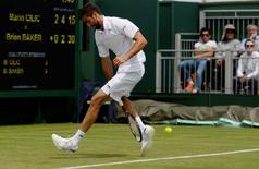 Britain Tennis - Wimbledon - All England Lawn Tennis & Croquet Club, Wimbledon, England - 27/6/16 Croatia's Marin Cilic in action during his match against USA's Brian Baker REUTERS/Tony O'Brien