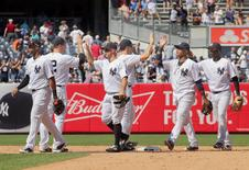 Jun 25, 2016; Bronx, NY, USA; The New York Yankees celebrate after defeating the Minnesota Twins 2-1 at Yankee Stadium. Mandatory Credit: Andy Marlin-USA TODAY Sports