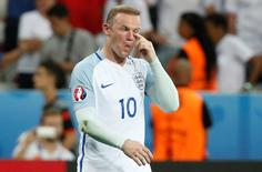 England's Wayne Rooney looks dejected at the end of the game. REUTERS/Eric Gaillard
