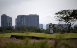 Golf - Rio 2016 Olympic Games Test Event- Rio de Janeiro, Brazil - 8/3/16 - Brazil's Miriam Nagl hits the ball. REUTERS/Ricardo Moraes