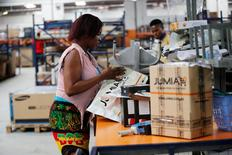 A woman works at the packaging unit at a warehouse for an online store, Jumia in Ikeja district, in Nigeria's commercial capital Lagos June 10, 2016.REUTERS/Akintunde Akinleye