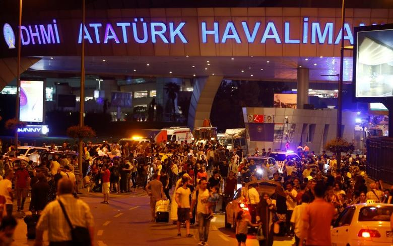 People leave Turkey's largest airport, Istanbul Ataturk, Turkey, following a blast June 28, 2016. REUTERS/Osman Orsal