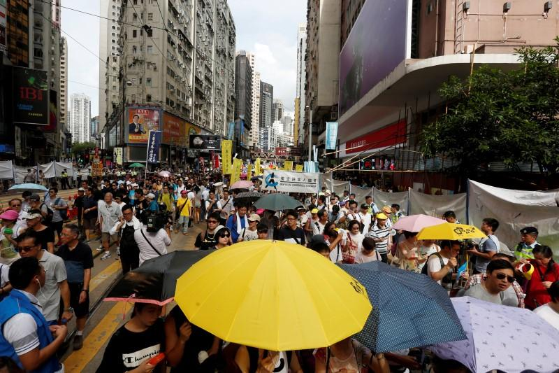 Tens of thousands protest in Hong Kong as China tensions simmer over booksellers