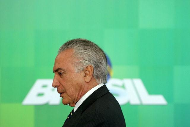 Brazil's interim President Michel Temer attends a ceremony of the social welfare program Bolsa Familia (Family Allowance) at the Planalto Palace in Brasilia, Brazil, June 29, 2016. REUTERS/Adriano Machado     TPX IMAGES OF THE DAY