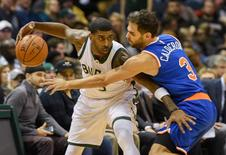 Dec 5, 2015; Milwaukee, WI, USA;   New York Knicks guard Jose Calderon (3) puts pressure on Milwaukee Bucks guard O.J. Mayo (3) in the second quarter at BMO Harris Bradley Center. Mandatory Credit: Benny Sieu-USA TODAY Sports