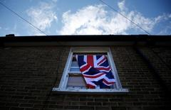 A British flag flutters in front of a window in London, Britain, June 24, 2016 after Britain voted to leave the European Union in the EU BREXIT referendum.       REUTERS/Reinhard Krause
