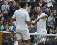 Britain Tennis - Wimbledon - All England Lawn Tennis & Croquet Club, Wimbledon, England - 2/7/16 Canada's Milos Raonic shakes hands with USA's Jack Sock after winning their match REUTERS/Toby Melville