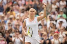 Jul 3, 2016; London, United Kingdom; Svetlana Kuznetsova (RUS) celebrates match point during her match against Sloane Stephens (USA) on day seven of the 2016 The Championships Wimbledon. Mandatory Credit: Susan Mullane-USA TODAY Sports