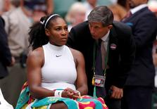Britain Tennis - Wimbledon - All England Lawn Tennis & Croquet Club, Wimbledon, England - 4/7/16 USA's Serena Williams talks to officials after slipping during her match against Russia's Svetlana Kuznetsova REUTERS/Andrew Couldridge