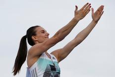 Athletics - Russian track and field championship - Women's pole vault - Cheboksary, Russia, 21/6/16. Yelena Isinbayeva greets spectators. REUTERS/Sergei Karpukhin
